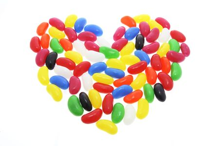 sweetness: Jelly Beans Arranged in Shape of Love Heart on White Background