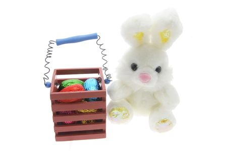 Easter Bunny with Easter Eggs in Wooden Box  photo