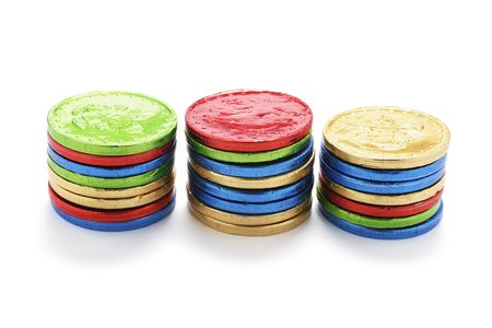titbits: Stacks of Chocolate Coins on White Background