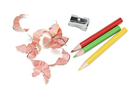 sharpenings: Colour Pencils and Shavings on White Background Stock Photo
