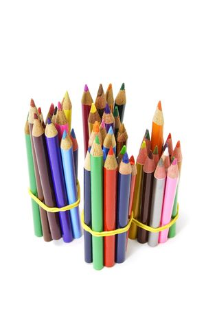 Bundles of Color Pencils on White Background photo
