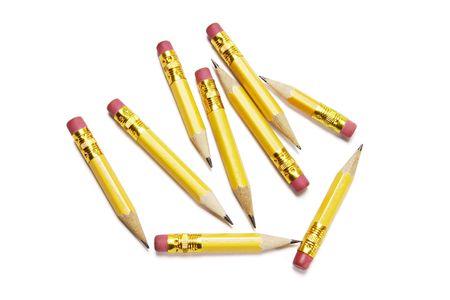 writing instruments: Short pencils on white background
