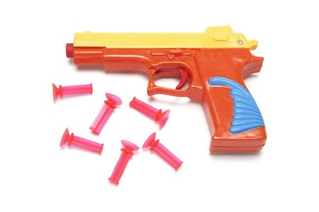 Toy Gun with Rubber Bullets on White Background Stock Photo - 3715230