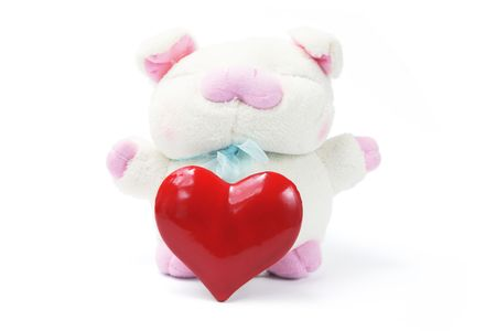 Soft Toy Pig with Love Heart on White Background photo