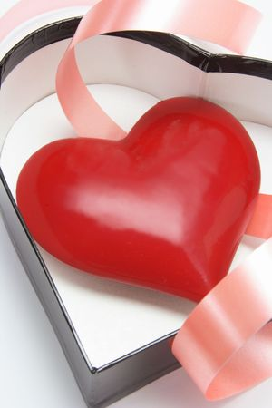 loveheart: Closeup of Red Heart Symbol in Heart-shaped Gift Box