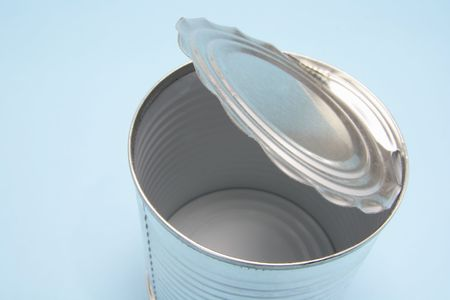 tin can: Empty Tin Can on Blue Background Stock Photo