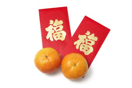 mandarins: Chinese New Year Red Packets and Mandarins on White Background