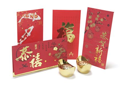 Gold Ingots and Red Packets on White Background photo