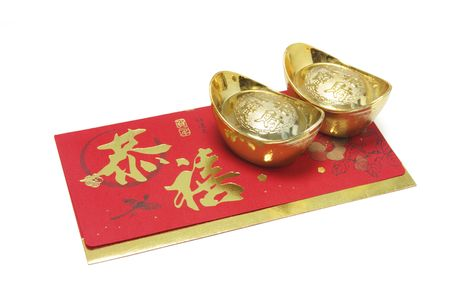 Gold Ingots and Red Packet on White Background photo