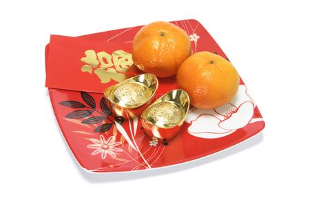 Mandarins, Gold Ingots and Red Packets on Plate on White Background photo
