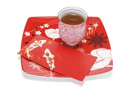 red packet: Cup of Chinese Tea and Red Packet on Plate on White Background Stock Photo