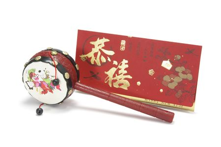 Chinese Tambourine and Red Packet on White Background photo