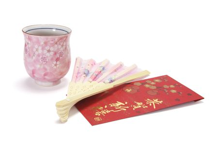 red packet: Cup of Chinese Tea with Chinese Fan and Red Packet on White Background Stock Photo