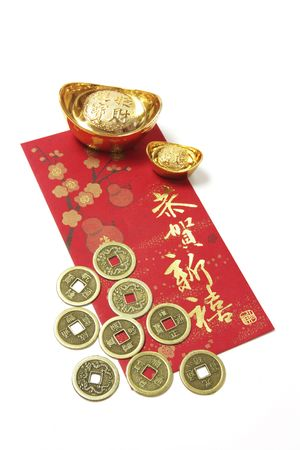 ingots: Chinese Coins and Gold Ingots on Red Packet on White Background