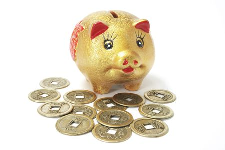 thrifty: Golden Piggy Bank with Ancient Chinese Coins on White Background