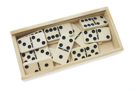 Domino Pieces in Box on White Background photo