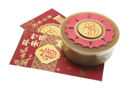 knock out: Chinese New Year Cake and Red Packets Stock Photo