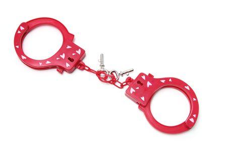 detained: Esposas de pl�stico sobre fondo blanco aisladas