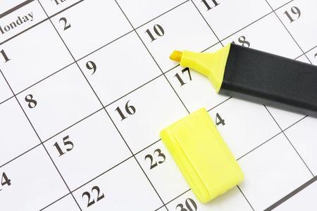 marker pen: Close Up of Yellow Marker Pen on Calendar