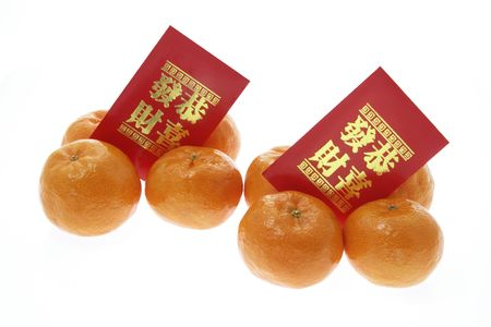 Mandarins and Red Packets on White Background photo