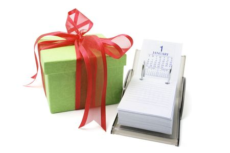 weeks: Gift Box and Desk Calendar on White Background