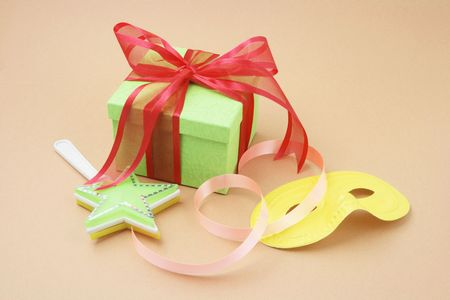 novelties: Gift Box and Party Favors on Warm Background