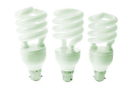 light bulbs: Bombillas fluorescentes compactas en el fondo blanco Foto de archivo