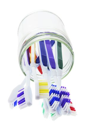 breadth: Toothbrushes in Glass Jar on White Background