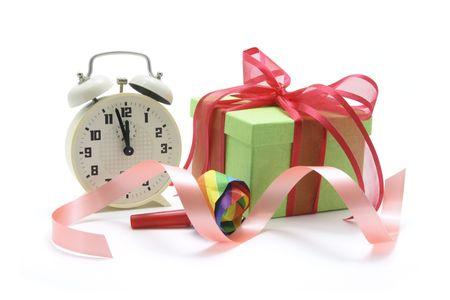 novelties: Alarm Clock and Gift Box on White Background Stock Photo
