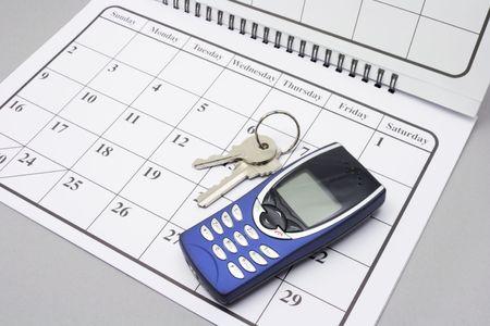 Mobile Phone and Keys on Calendar Stock Photo - 3870444