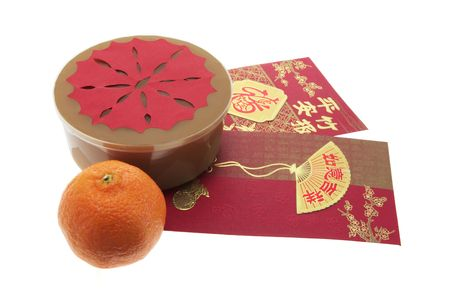Chinese New Year Cake and Red Packets photo