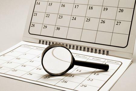 agenda year planner: Magnifying Glass on Calendar in Warm Tone