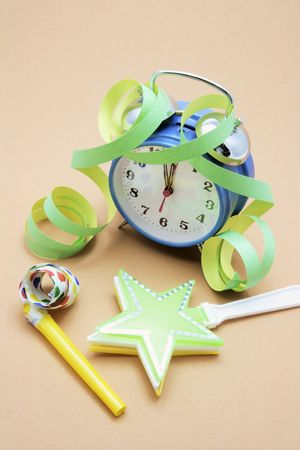 party favors: Alarm Clock and Party Favors on Warm Background