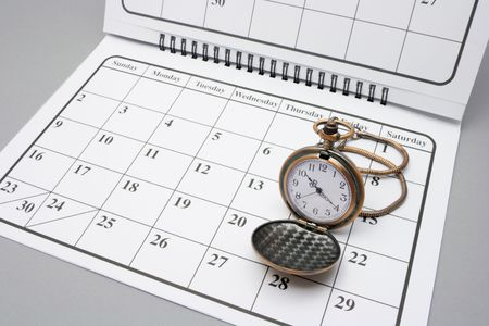 weeks: Pocket Watch on Calendar with Grey Background