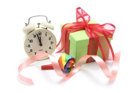 novelties: Gift Box and Clock on Isolated White Background Stock Photo