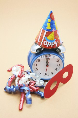 Alarm Clock and Party Favors on Warm Background photo