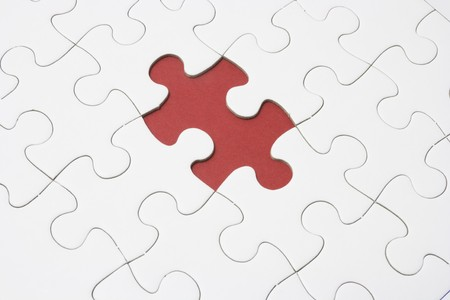 Close Up of Jigsaw Puzzle with Missing Piece