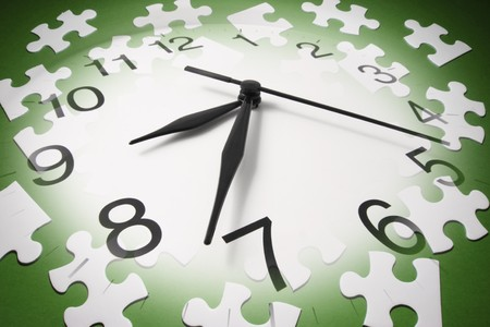 green tone: Jigsaw Puzzle Pieces and Clock in Green Tone