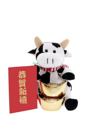 Soft Toy Cow with Chinese New Year Decorations on White Background. photo