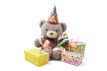 Teddy Bear with Party Favors and Gift Boxes on White Background photo