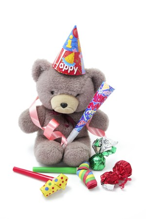 Teddy Bear with Party Favors on White Background photo