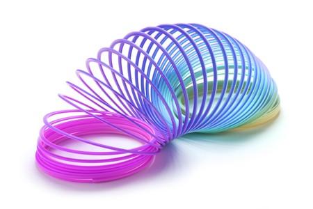 slinky: Slinky on Isolated white background Stock Photo