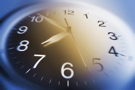 timely: Close Up of Clock Face in Blue and Warm Tone