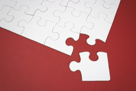 linkage: Close Up of Jigsaw Puzzle with Missing Piece