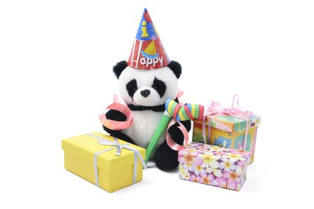 party favors: Toy Panda with Party Favors and Gift Boxes on White Background Stock Photo