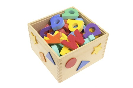 tidiness: Alphabets in Wooden Box on White Background