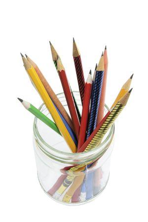 Pencils on Glass Jar on White Background photo