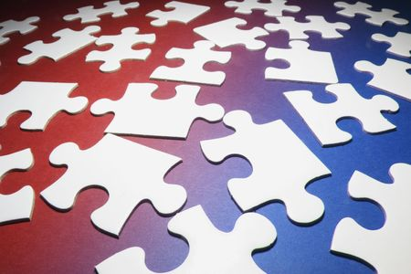 Jigsaw Puzzle Pieces on Red and Blue Background Stock Photo - 4746543