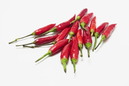 pungency: Red Chillies on Seamless White Background