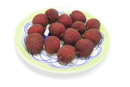 lychees: Lychees on a Plate on White Background Stock Photo